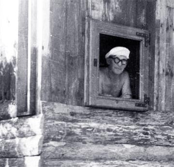 an unusual shot of le corbusier at a window of the cabanon fondation le corbusier adagp u unknown